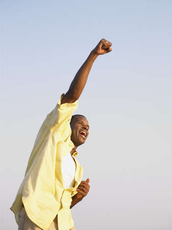 idealism: Young man punching the air in triumph