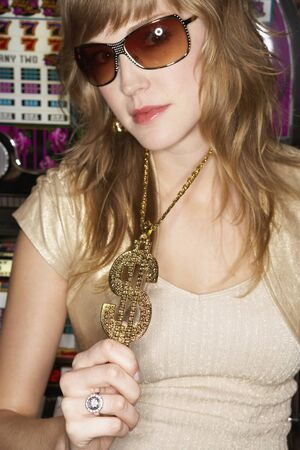 dollarbill: Young woman wearing a pendant and sunglasses LANG_EVOIMAGES