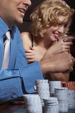 Couple gambling in a casino