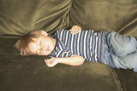 3 4 length: Boy sleeping on a couch