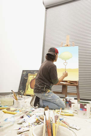 casualness: Male artist painting