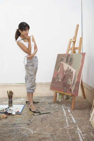 toiling: Female artist painting