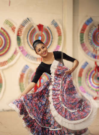 ethnic dress: Young woman in ethnic dress dancing