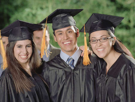 mischievious: Graduates smiling for the camera LANG_EVOIMAGES