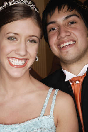 eveningwear: Teenage couple smiling for the camera in formal wear LANG_EVOIMAGES