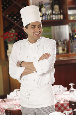 spectating: Chef posing for the camera in a restaurant