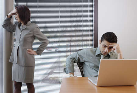 office space: Frustrated businesspeople in office space