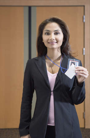 credentials: Businesswoman showing her credentials