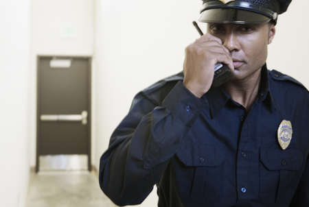Security guard using a walkie-talkie Stock Photo