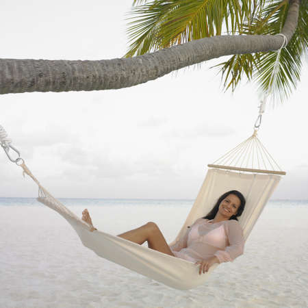 mate married: Young woman relaxing in a hammock