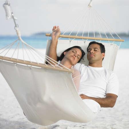 honeymooner: Couple sleeping in a hammock LANG_EVOIMAGES