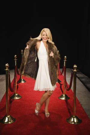 nite: Female celebrity walking down empty red carpet