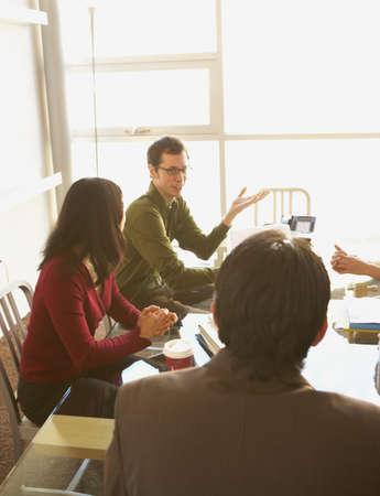 ajar: Businesspeople having a meeting