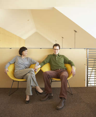 casualness: Businesspeople relaxing in office space
