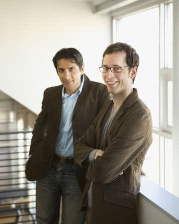 shaming: Businessmen smiling together