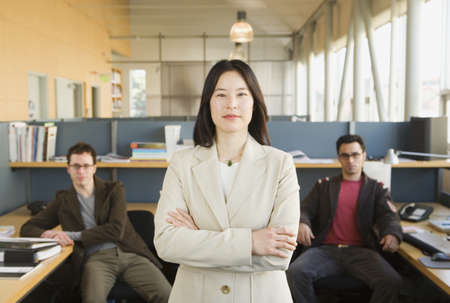 two persons only: Businesswoman standing in office space