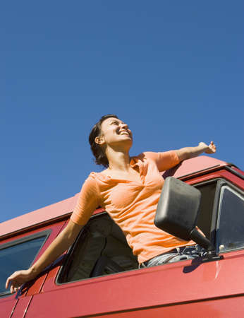 lighthearted: Woman leaning out of car window