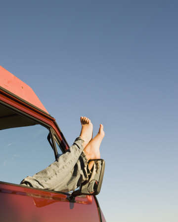 window view: Womanís feet sticking out of car window