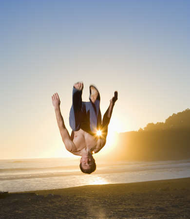 nite: Man jumping for joy on the beach