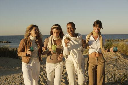 Women walking on the beach together Stock Photo