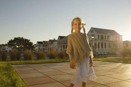 nite: Young girl standing in backyard