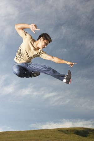 adventuresome: Man jumping for joy LANG_EVOIMAGES