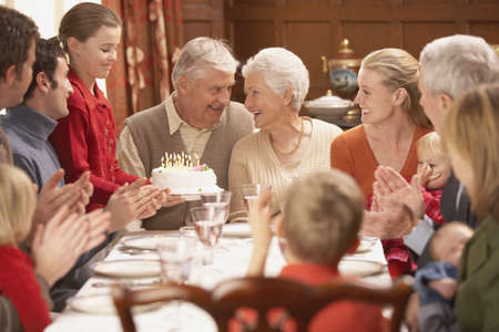 dinner: Grandmother with birthday cake and family at dinner table, Richmond, Virginia, United States