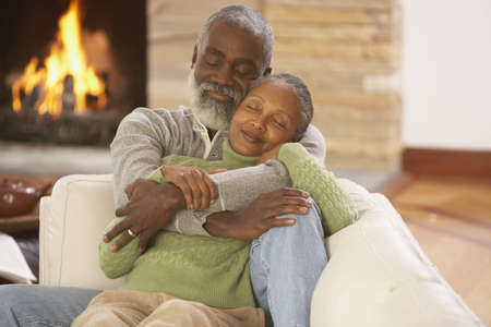 care giver: Senior African couple hugging on the sofa, Richmond, Virginia, United States