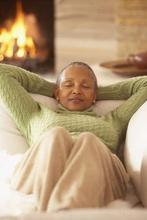 slumbering: Senior African woman relaxing on the sofa, Richmond, Virginia, United States
