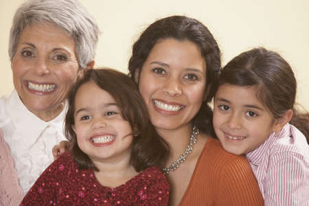 holding family together: Female Hispanic family members smiling, Richmond, Virginia, United States