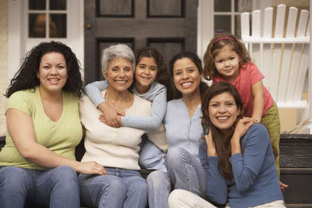 hispanic americans: Female Hispanic family members sitting on the porch smiling, Richmond, Virginia, United States