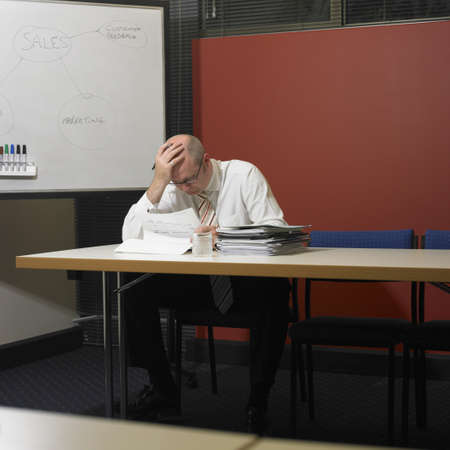 talker: Middle-aged businessman reading paperwork, Perth, Australia