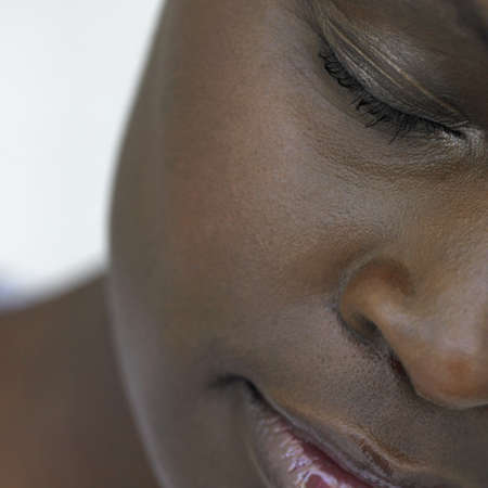 nostril: Close up African womans face, Perth, Australia LANG_EVOIMAGES