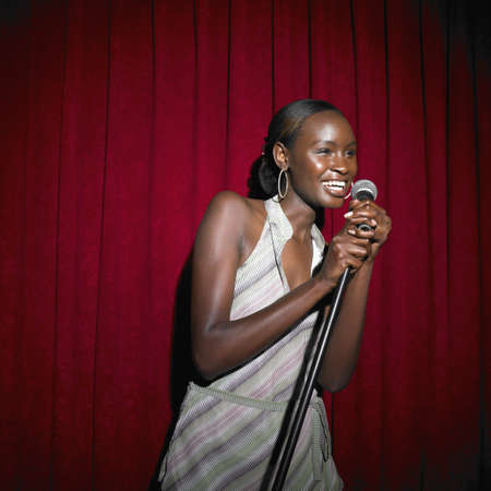 australian ethnicity: Young African woman with microphone, Perth, Australia
