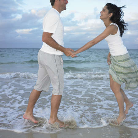 busselton: Couple playing in the surf, Busselton, Australia LANG_EVOIMAGES