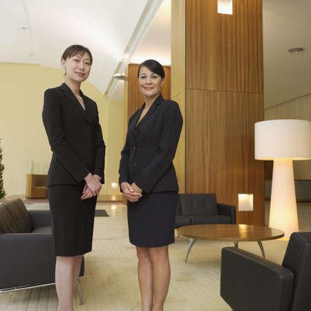 australian ethnicity: Two businesswoman standing in lobby