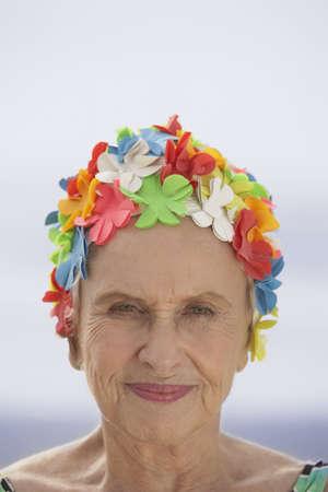 togs: Close up of senior woman wearing swim cap