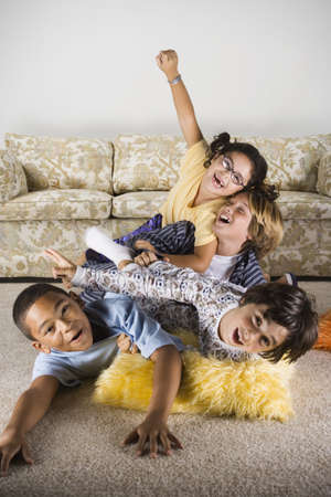 north western european descent: Group of children playing on the livingroom floor LANG_EVOIMAGES
