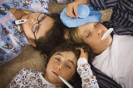 hermosa beach: Group of sick children in pajamas on the floor