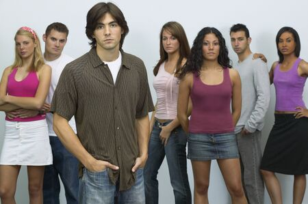 casualness: Group of young people looking serious