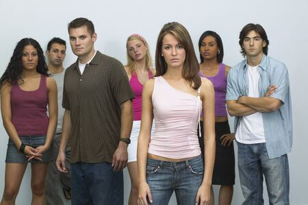 Group of young people looking serious