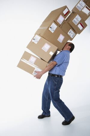 toiling: Studio shot of male warehouse worker carrying packages