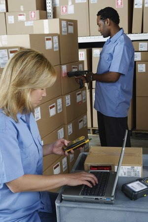 gaithersburg: Male and female warehouse workers in warehouse