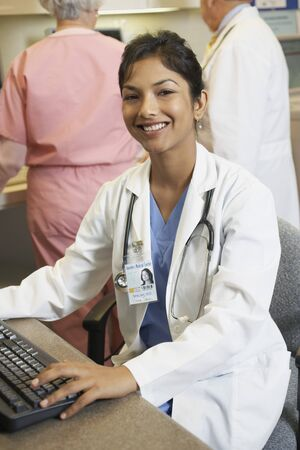 Young Indian female doctor at computer, Bethesda, Maryland, United States Stock Photo