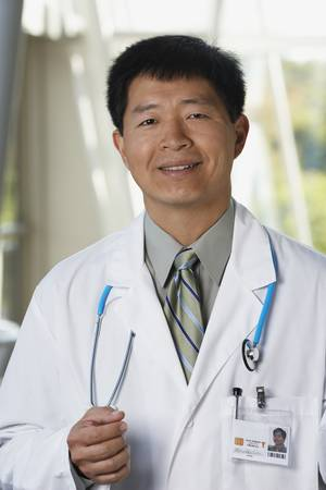 Middle-aged male Asian doctor