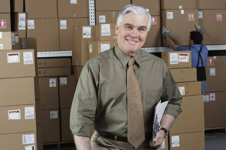 warehouse: Businessman standing in warehouse