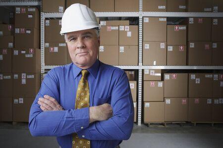 gaithersburg: Businessman wearing hard hat in warehouse