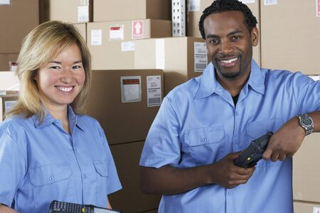 warehouse: Male and female warehouse workers in warehouse