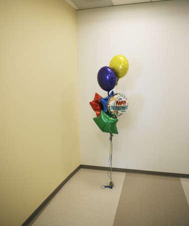 mid life: Bunch of retirement balloons in corner LANG_EVOIMAGES