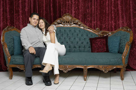 lighthearted: Couple sitting on an antique sofa